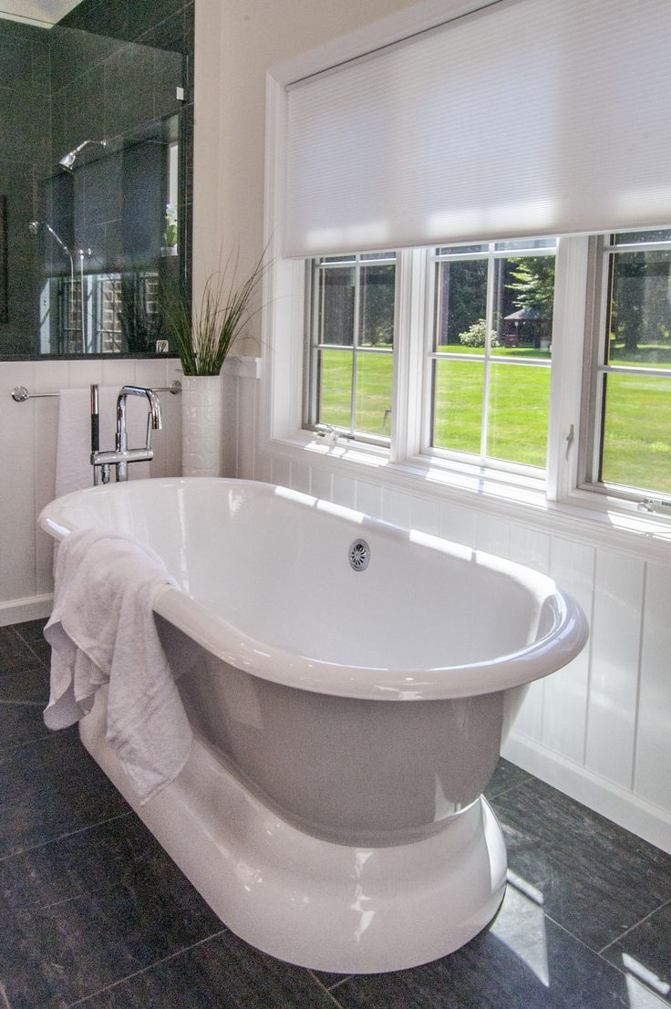 The Gardner/Fox team reconfigured the floor plan to accommodated a more spacious & luxurious master bath. The newly revamped master suite incorporates a large walk in shower with two shower heads, his & her vanities, a freestanding pedestal tub, and a makeup table with pendant lighting.