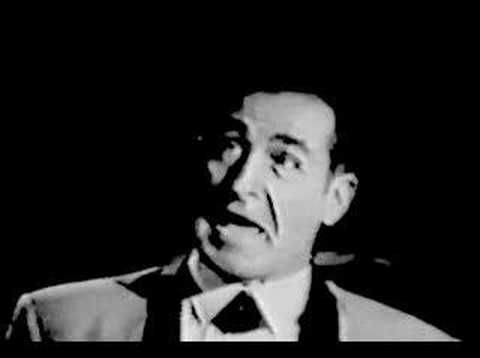 Here it is... Sheb Wooley singing Purple People Eater (1958). Imagine doing a ballet recital to THIS song!!! You can see why I remember it so clearly!