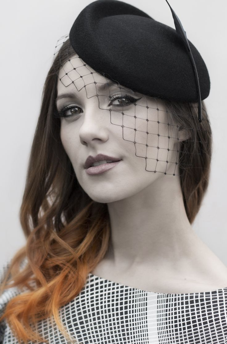 Seductive black sculpted cocktail hat with veil and feather. Dark eyes, makeup. https://www.etsy.com/uk/listing/197726437/birdcage-veil-headpiece-womens http://www.maggiemowbraymillinery.com/autumn-winter-2014/