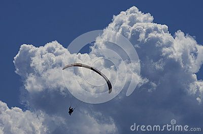 Paraglider With Clouds And Blue Sky