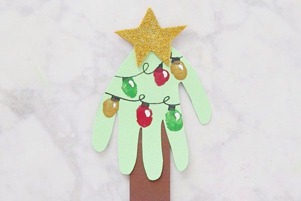 This Handprint Christmas Tree card is too cute!