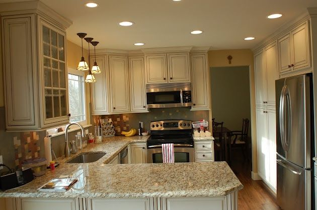 Small Kitchen Remodel... I love the cream cabinets