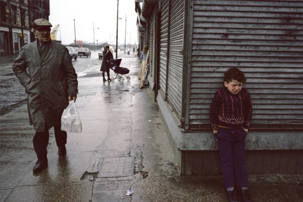 Raymond Depardon: Glasgow, 1980.   I like that the photographer has captured the boy hidding from what seems to be the old man who looks slightly angry .Seems very dramatic