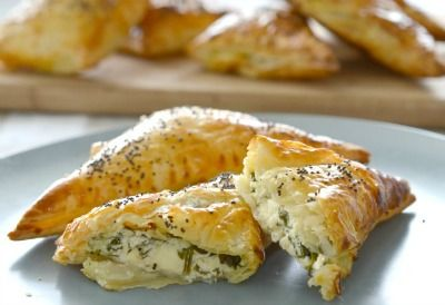 These Spinach and Three Cheese Triangles (yep, you read that right!!) are the ULTIMATE in easy and delicious party finger food. I decided to give these a try after hearing great feedback from a few people who had added feta to my Spinach and Ricotta Rolls recipe and I was certainly not disappointed.