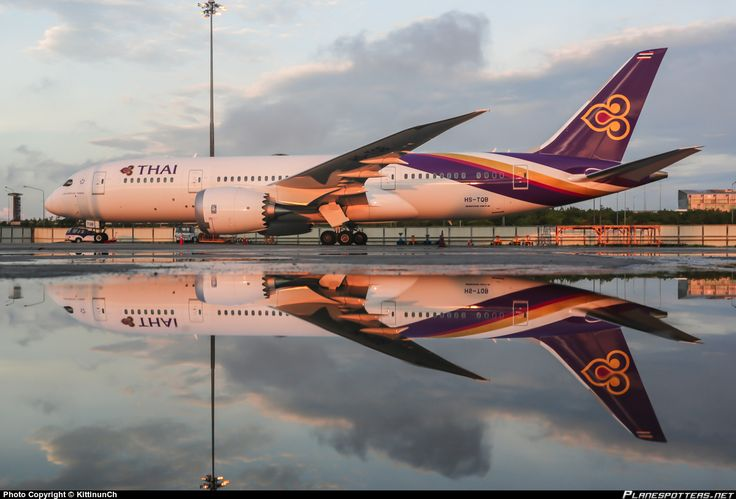 "Thai Airways International Boeing 787-8 Dreamliner HS-TQB ""Chaturaphak Phiman"" basking in its own reflection while parked on the remote stand at Bangkok-Suvarnabhumi, October 2014. (Photo: KittinunCh)"
