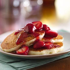 These gluten free pancakes are filled with mini cream cheese bites and topped with a strawberry sauce.