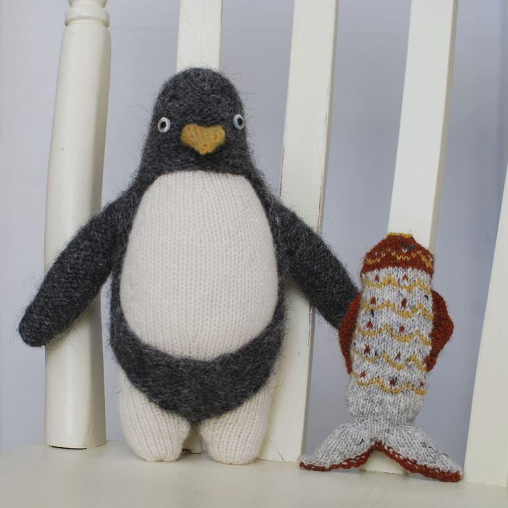 Knitted penguin and fair isle fish