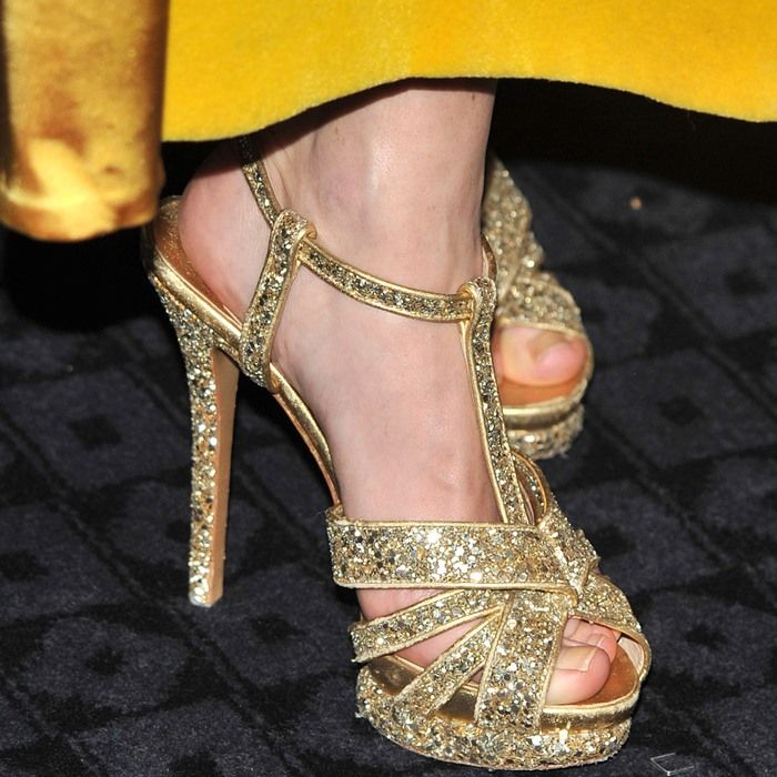 Anna Friel in glittery gold t-strap heels from Nicholas Kirkwood