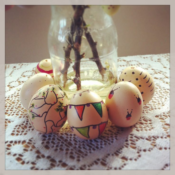 Easter crafts: free range chicken eggs blown and drawn on with a sharpie pen.