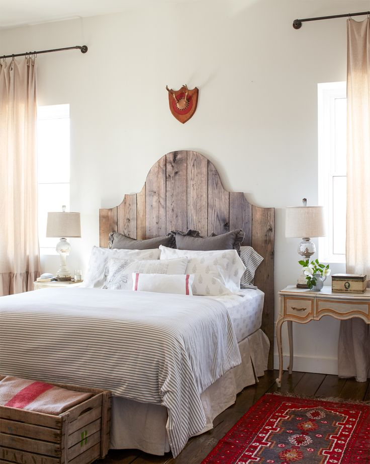"""Composed of red oak, the dramatic shape of the """"Duchess"""" bed  (that headboard!) creates the perfect rustic-meets-refined effect. This cabin's bedroom gas a shabby chic look that we cannot get enough of."""