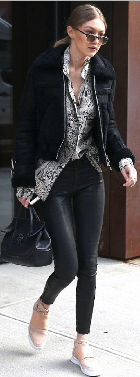Who made Gigi Hadid's black leather pants, print gray top, tan sneakers, shearling jacket, and handbag?