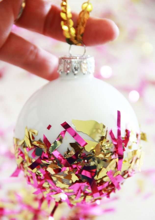Add some glitz to plain ornaments by dipping them in confetti or tinsel.