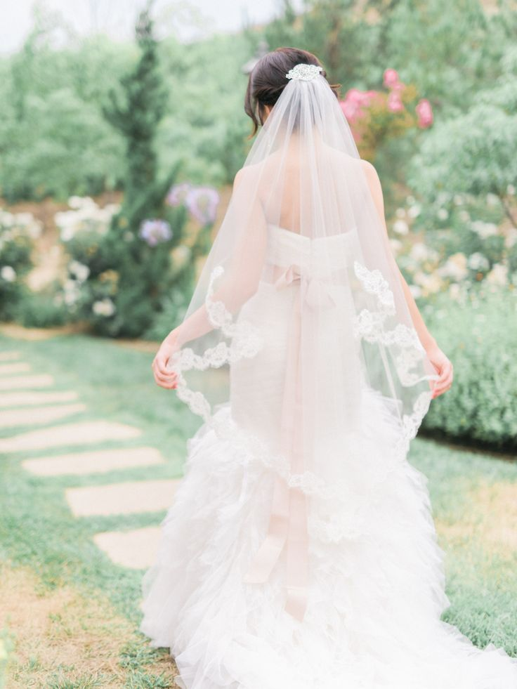 Ballet Veil: Also called Waltz veils (because you can still dance in them!), ballet-length veils fall somewhere between your knees and your ankles, giving you the drama of a longer veil without the tripping hazard.