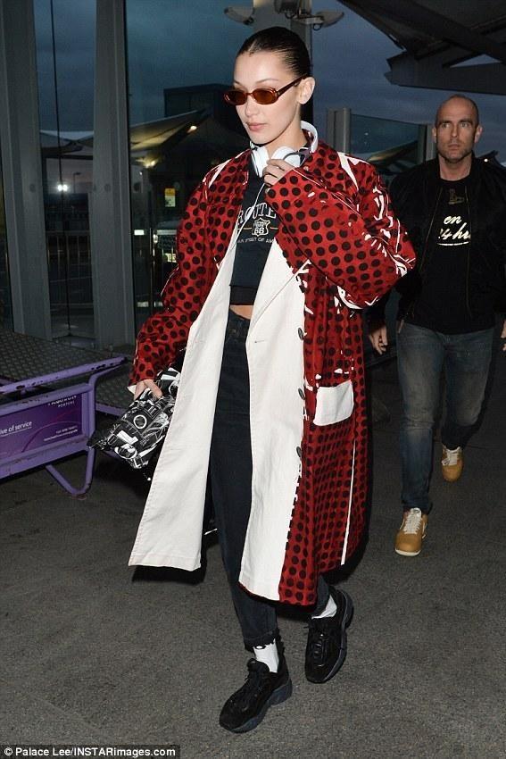 a9d3e91401fd Bella Hadid wearing Prada Spring 2018, Prada Printed Calf Leather Belt Bag,  Beats Ep On-Ear Headphones in White, Acne Studios Manhattan Black Sneakers,  ...