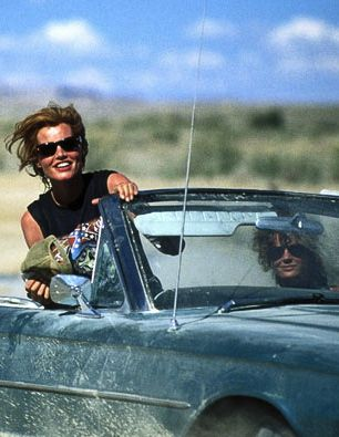 "Thelma & Louise: Thelma say's,""Are you sure we should be drivin like this, I mean in broad daylight and everything?"" Louise replie's,""No we should'nt, but I want to put some distance between us and the state of our last god damn crime!!!"