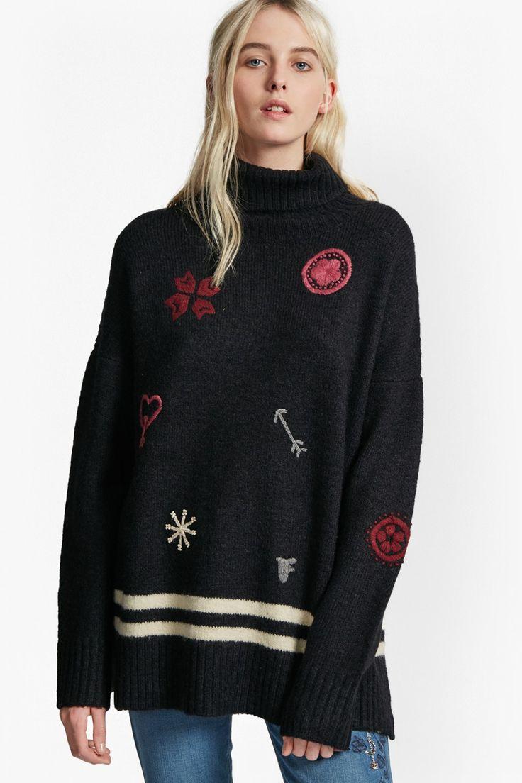 <ul> <li> Knitted jumper with decorative embroidered patches and stripes</li> <li> High, roll neck</li> <li> Long sleeves with dropped shoulders</li> <li> Deep ribbed trims</li> <li> Pull-on style</li> <li> Oversized fit —falls generously over the body</li> <li> UK size M length from high shoulder neck point to hem is 66cm</li> </ul>  <strong>Our mod...