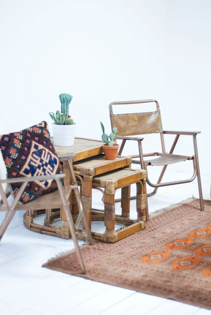 Southwestern Inspired Styled Lounge with Metal and Leather Folding Chairs and an Orange and Brown Masculine Rug via Birch & Brass Vintage Rentals for Weddings and Special Events.