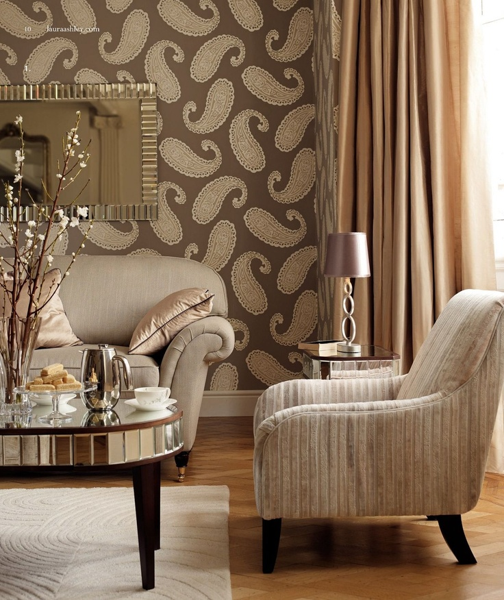 Nice upholstered and mirrored furniture, wallpaper and drapes!