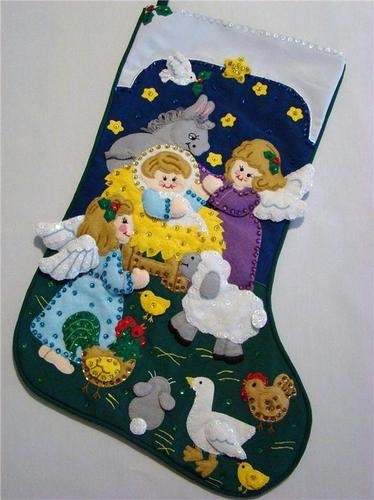 "This wonderful hand~crafted Christmas Stocking called ""BABY JESUS"" is made of felt applique on cloth and beautifully decorated with hand sewn sequins and beads.  There is room at the top to have a special name embroidered.  A precious Baby's First Christmas Stocking."
