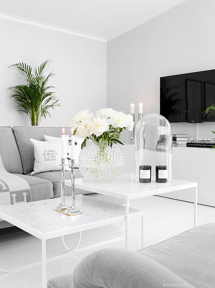 White bright livingroom decor with grey sofa