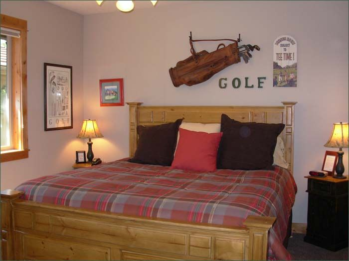 the third master bedroom follows a golf theme and features a generous king sized bed