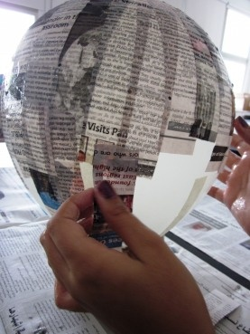 paper mache over balloon. pop balloon. place glow sticks inside after decorating then hang on a string for big effect