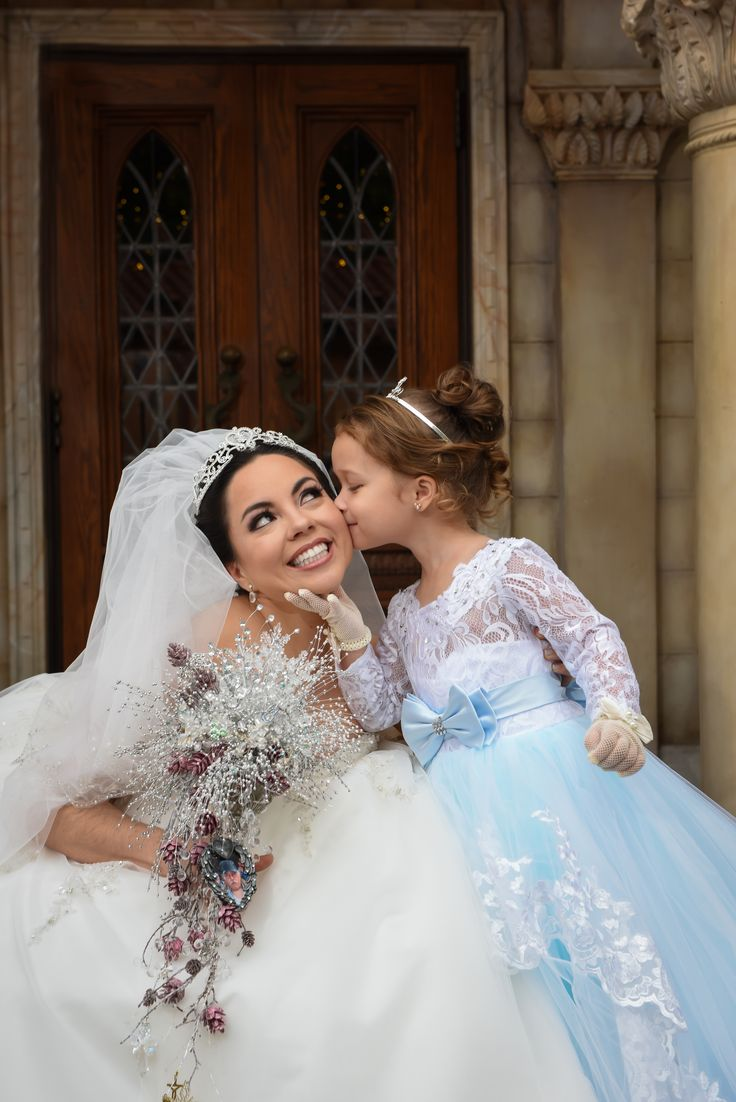 A sweet little kiss from her flower girl in the Italy Pavilion. Photo: Jacob, Disney Fine Art Photography