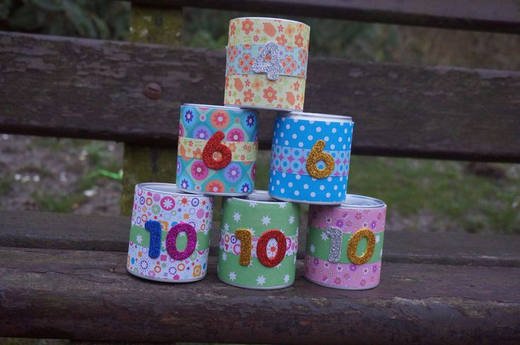 Decorate some empty cans and stack them. Children will have to throw balls at it to knock over all the cans.