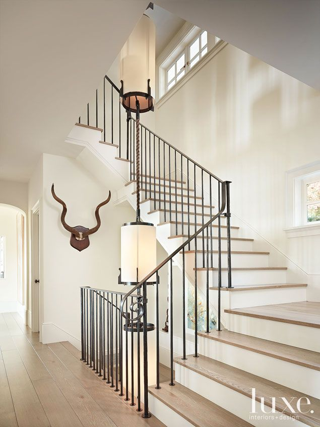 A Mercer Island home's open #metal #staircase. See more at www.luxesource.com. #luxe #luxemag #luxury #design #interiordesign #interiors #home #house #dwelling #residential #decor #homedecor #interiordecorating #interiordesignideas #architecture #stairs
