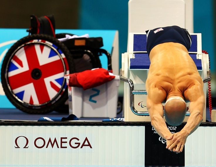 2012 Paralympics: James O'Shea of Great Britain dives from the blocks in the Men's 100m Breaststroke - SB5 Final.