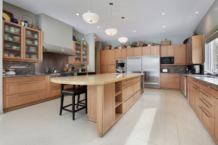 This light wood kitchen is bright, airy and full of light. It also has high-end stainless steel appliances.
