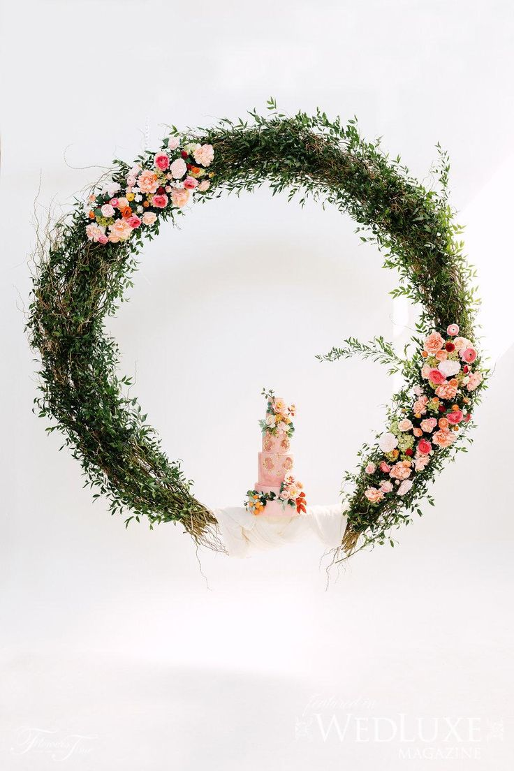 Amalfi Shoot Wedluxe circular floral swing wedding backdrop #cake#greenery#pink#red