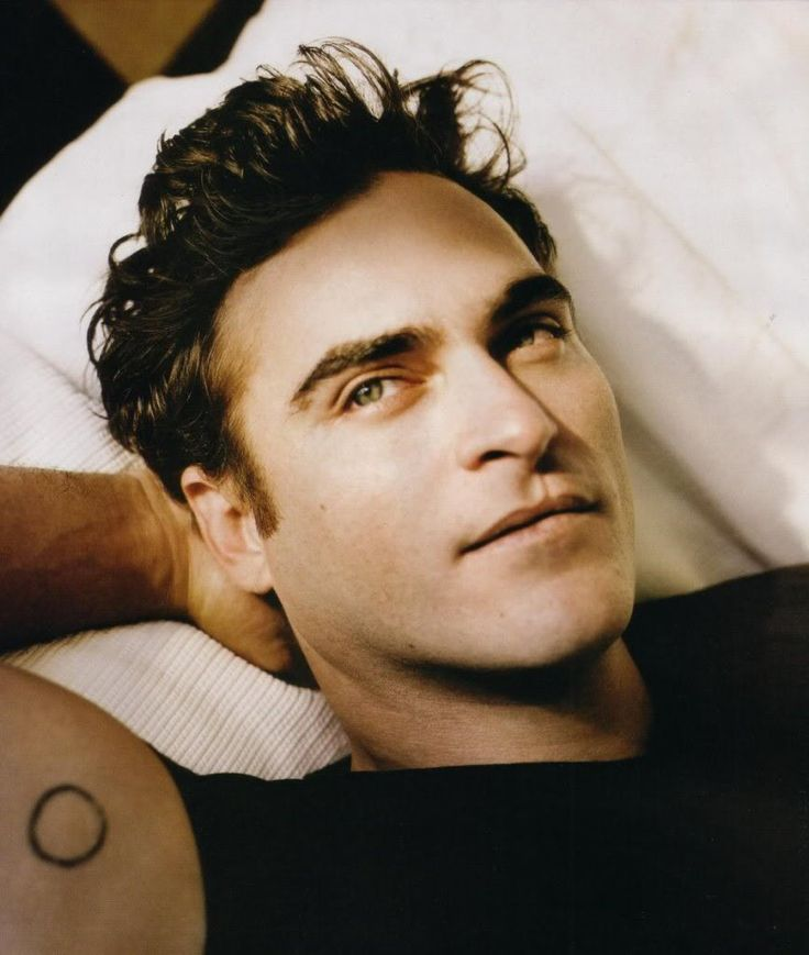 "Joaquin Phoenix... makes me wanna watch ""Walk the Line"" :)"