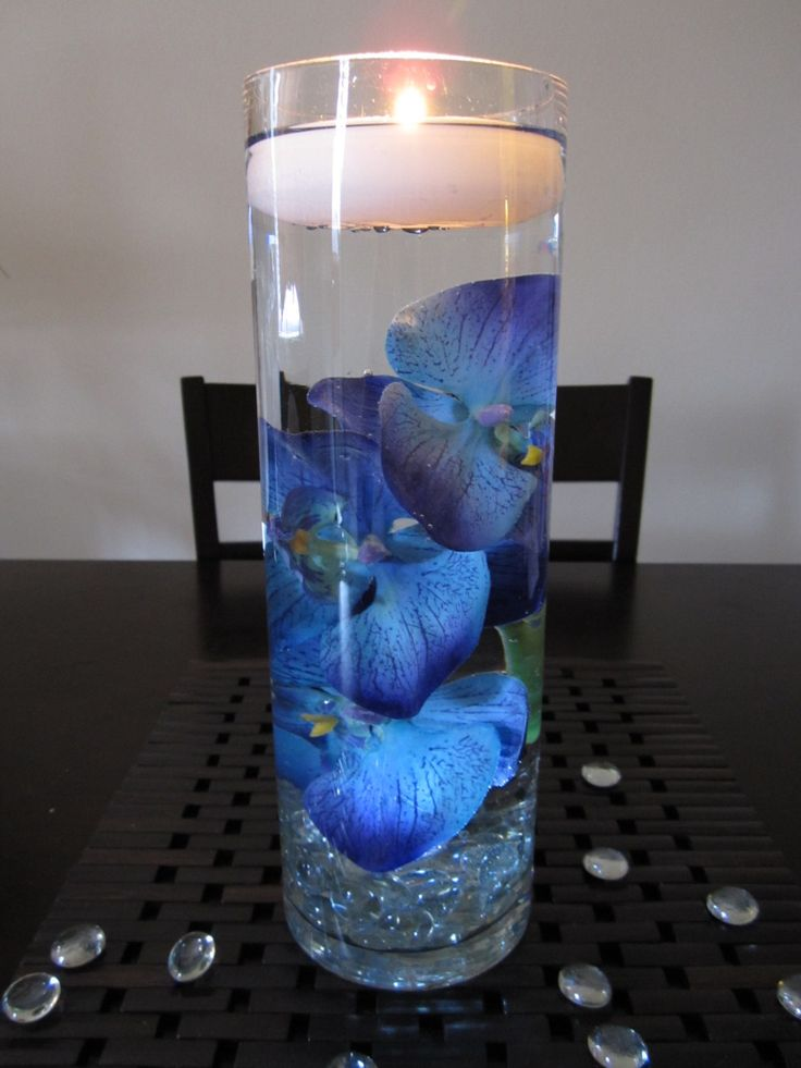 blue floating candle centerpieces | Blue Purple Orchid Centerpiece uplighting no candles