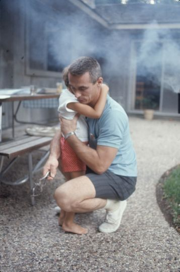 Early Astronauts at Home with Their Families in Houston - American NASA astronaut Eugene Cernan crouches down to hug his daughter, Tracy.
