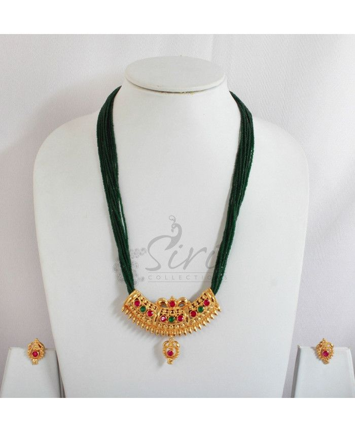 Green small cut beads with changeable kemp pendant set. Chain length-18.5 inch, pendant length- 2, width-2.5 inch, earrings-0.75 inch approx