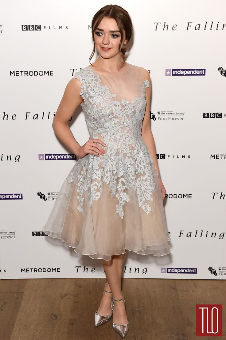 Maisie Williams in a Narces silk organza embroidered lace dress paired with jewelry Monica Vinader and Phoebe Coleman.