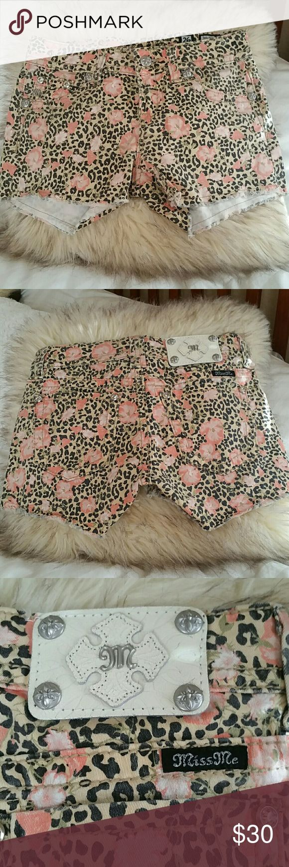Miss Me cheetah shorts size 26 Excellent like new condition, worn once for a few hours! Super cute cheetah print with coral colored flower design! Get ready for spring and summer with these! Miss Me Shorts Jean Shorts