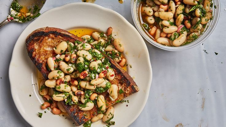 These marinated beans keep for days, and you can put them on toast, salad, pretty much anything that needs some umph.