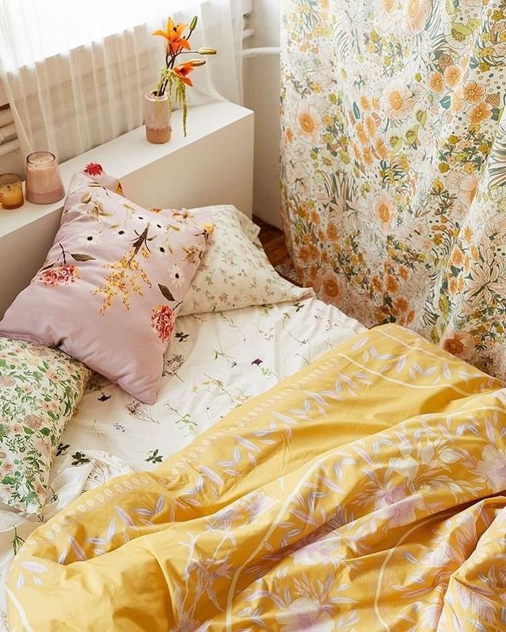 The mixed-pattern, super colorful, all-flower-everything bedroom of our dreams. @UrbanOutfittersHome #UOHome
