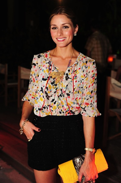 love the whole look: sheer floral blouse, short skirt, bright yellow clutch- so perfect