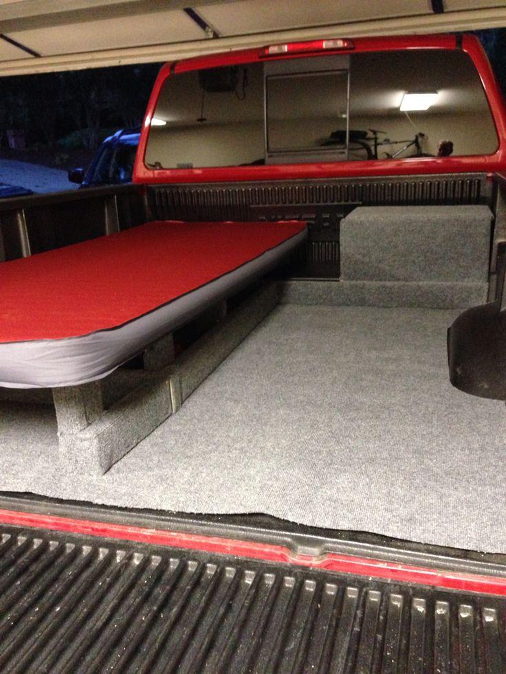 Nissan Titan converted into a mini camper. Camper shell is in order and the work is still in progress. Bed is 18 inches tall allowing for storage under. Battery box (doubles as a shelf for tv/DVD) is on the far right and will house a deep cell battery with solar power charger. Small shelf to the right of the bed. All pieces are removal since this will only be used occasionally for camping and fishing.