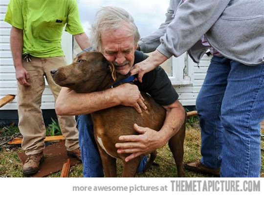 A man with his dog after the tornado in Alabama