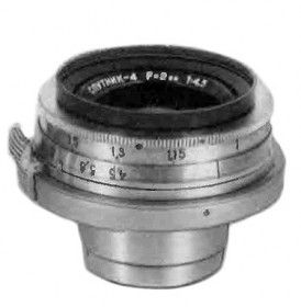 Soviet and Russian Cameras - Sputnik-4: PT0105. Prototype lens, calculated in 1959 by GOI. Very few samples released by GOI in 1959-1960. Focal length - 2 cm, aperture range f4.5 - f22. Focusing range from 0.5m to infinity. Number of elements/groups: 8/5.  Angular field - 92º. Kiev (Contax) mount. An earliest so far known lens has s/n #60036407 (private coll.).