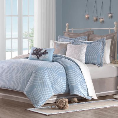 This I could sleep in - The colors of the sea, sky, clouds and sand are reflected in this beautiful collection. The woven geometric design of blue and white with accents of sand slubbed cotton make up the filled duvet and standard shams. The Euro shams and adjustable bed skirt have a contrasting white trim for added detail. The coastal motifs of the embroidered pillows complete the ensemble.