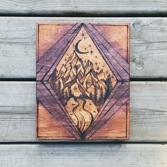 Wood burned mountains Light will guide you home Mountain