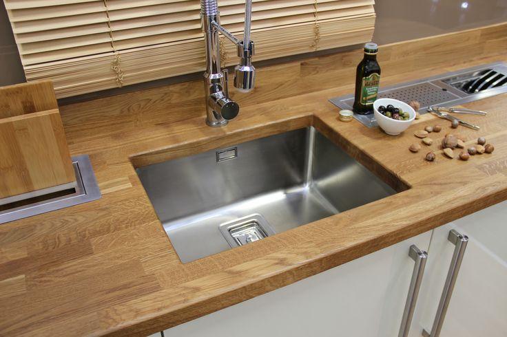 Solid Oak worktop with Franke under-mount stainless steel sink.