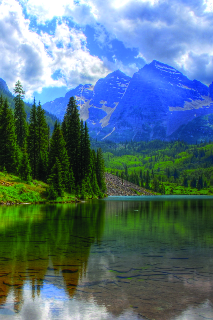 Travel | Colorado | Attractions | USA | Enchanting Spots | Destinations | Places To Visit | Day Trips | Adventure | Outdoors | Things To Do | Blue Lakes | Natural Beauty | Paint Mines | Maroon Bells | Aspen | National Parks | Scenic Hikes | Natural Springs | Garden of the Gods | Red Rocks