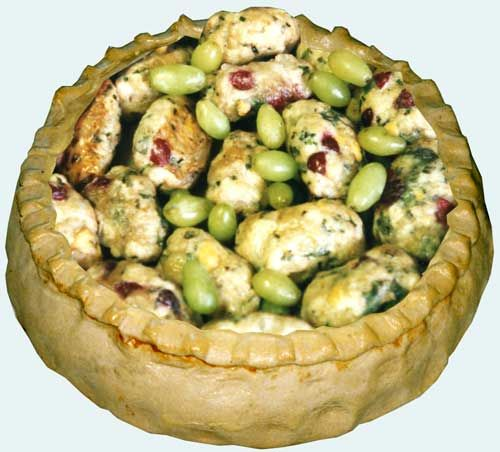 Robert May's Lumber Pie before being covered with a 'cut lid' _ This is one of the great 'sweet-sour' pies of the early modern period. The name is a corruption of Lombard Pie. The little balls of lumber Meat, usually made from Veal, sometimes enclosed a little nugget of Bone Marrow & would have had a soft centre like a Chicken Kiev. Other forgotten English pies in this ancient sweet-sour tradition were dowlett pie, spring pie & stump pie. From Robert May The Accomplisht Cook (London: 1660).