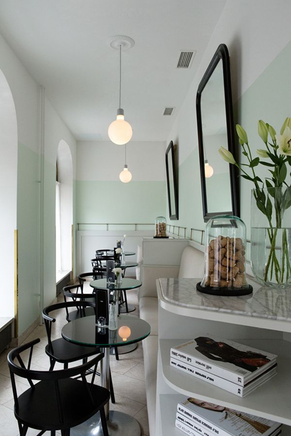 Pale mint green wall with black and white furnitures